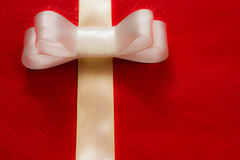 White gift ribbon and bow on red background. Some other you may also like Royalty Free Stock Image