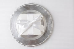 White Gift Silver Plate Stock Photography