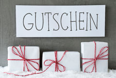 White Gift On Snow, Gutschein Means Voucher Royalty Free Stock Images
