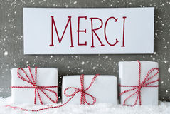 White Gift With Snowflakes, Merci Means Thank You Stock Photo