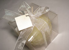 White gift with tag. White gift box with candle in it and a tag Royalty Free Stock Photography