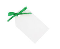 White gift tag with green bow Royalty Free Stock Photo