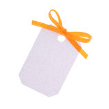 White gift tag with orange ribbon bow Royalty Free Stock Photography