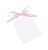 White gift tag with ribbon bow Stock Photography