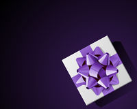 White gift top view with violet bow Royalty Free Stock Photos