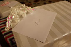 White gift wrapped with ribbon Stock Image