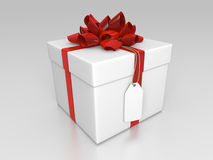 White giftbox with red ribbon and label Royalty Free Stock Photography