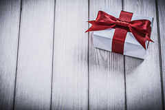 White giftbox on wooden board holidays concept Stock Images
