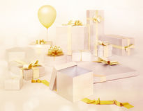 White gifts boxes with golden bows, balloon isolated on white ba. Ckground Stock Photo