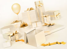 White gifts boxes with golden bows, balloon isolated on white ba. Ckground. Horizontal Royalty Free Stock Image