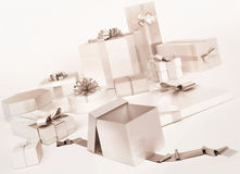 White gifts boxes with silver bows  . White gifts boxes with silver bows   on white background Stock Images