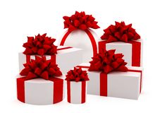 White gifts with red ribbons Royalty Free Stock Photos