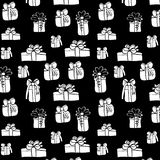 White gifts seamless pattern on black background Royalty Free Stock Photos