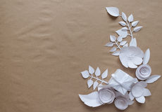 White gifts and white paper flowers. On the wooden background Royalty Free Stock Photos