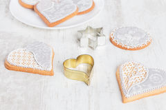 White gingerbread cookies in heart shape with cookie cutter Royalty Free Stock Images