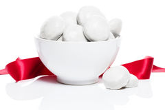 White gingerbread cookies in a white bowl with a red ribbon Stock Image