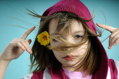 White girl feeling spring. Yellow flower in hair Royalty Free Stock Photos