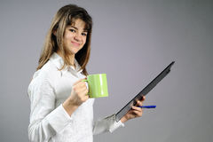 White girl learning and drinking cup of tea Stock Photos