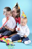 White girl playing with two beautiful boys Stock Photography