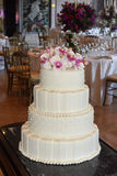 White Glacé with Pearls and Pink Flowers, Wedding Cake Dinner Party Stock Photography