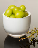 White glass bowl full of green grapes Stock Images