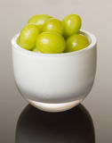White glass bowl full of green grapes Royalty Free Stock Photography