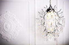 White glass chandelier on white background n classical interior Royalty Free Stock Photo