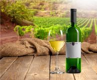 Glass and bottle of white wine on light background Royalty Free Stock Photography