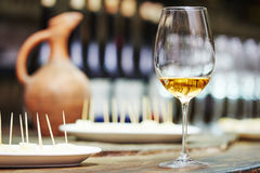 White glass of wine for tasting. White wine glass for tasting or degustation in the cellar Stock Photos