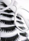 White Glasses and False Eyelashes. Beauty fashion concept with white eyeglasses and black fake eye lashes Stock Photography