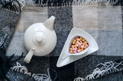 White glazed donuts and colored marshmallow in a cup of hot chocolate  on plaid in Scandinavian style. Healthy drink and sweet  food in summer. Flat lay, Top Stock Photos