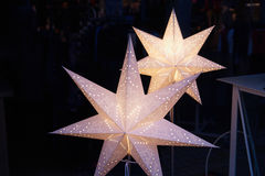 White glittering beautiful star shaped Christmas decoration. White glittering beautiful handmade star shaped Christmas decoration with dark background royalty free stock images