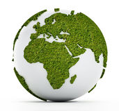 White globe with continents covered with grass Royalty Free Stock Photos