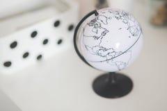 White globe on a desk Stock Photography