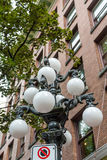 White Globes on Classic Old Lamp Post Stock Images