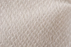 White glossy cloth. White glossy textile pattern with sidled threads Stock Photo