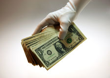 White glove stack of cash Royalty Free Stock Image