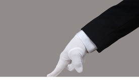 White Glove Test. Profile of a white glove running a finger across a clean surface Royalty Free Stock Images