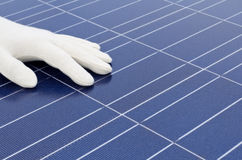 White gloved hand in front of solar cells Stock Images
