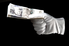 White gloved hand holding twenty pound notes. Isolated on a black background Royalty Free Stock Image