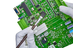 White gloved hands and brush cleaning computer circuit board cpu Stock Photography