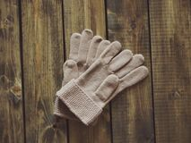 White Gloves on Brown Wooden Surface Stock Photography