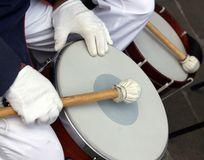White gloves of drum player in the band Royalty Free Stock Photography