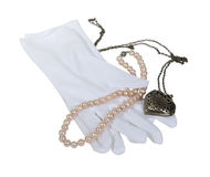White Gloves with Pearls and Heart Locket Royalty Free Stock Photography