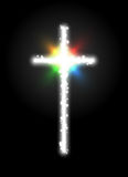 White Glow Sparkling Cross with Multicolor Flare on black background Royalty Free Stock Image