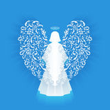 White glowing angel and halo. Praying angel with ornamental white wings and glowing nimbus on a blue background. Beautiful angel silhouette with ornamental stock illustration