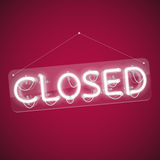 White Glowing Neon Closed Sign Stock Image