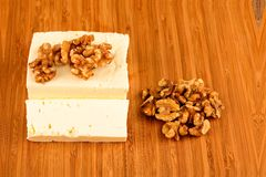 White goat cheese with noble rot. On wooden table Royalty Free Stock Images