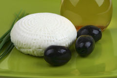 White goat cheese and olives Stock Photo