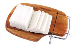 White goat cheese and slice on wooden plate Royalty Free Stock Images